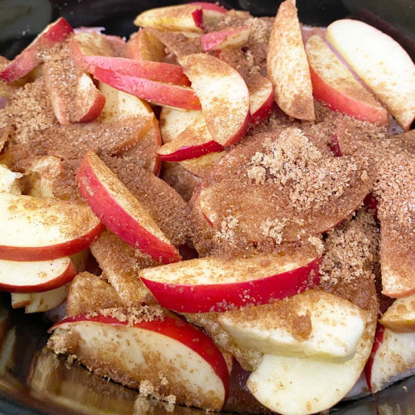 preparing apple brown sugar pork chops in the Crock Pot